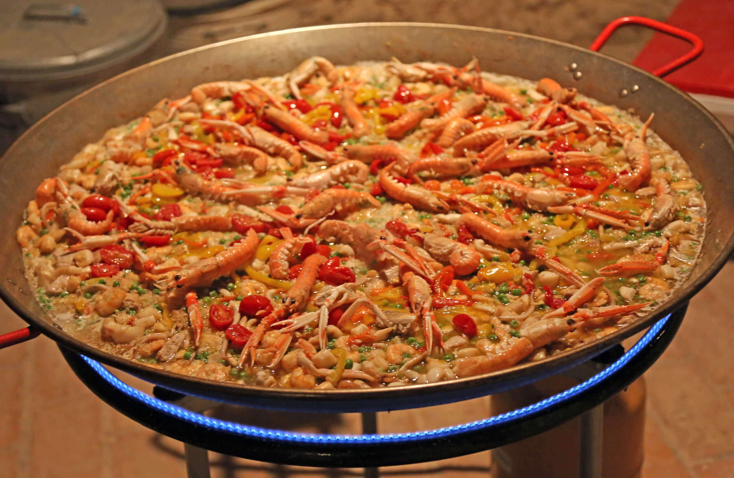 Sydney Paella catering cooking paella with prawns and rice