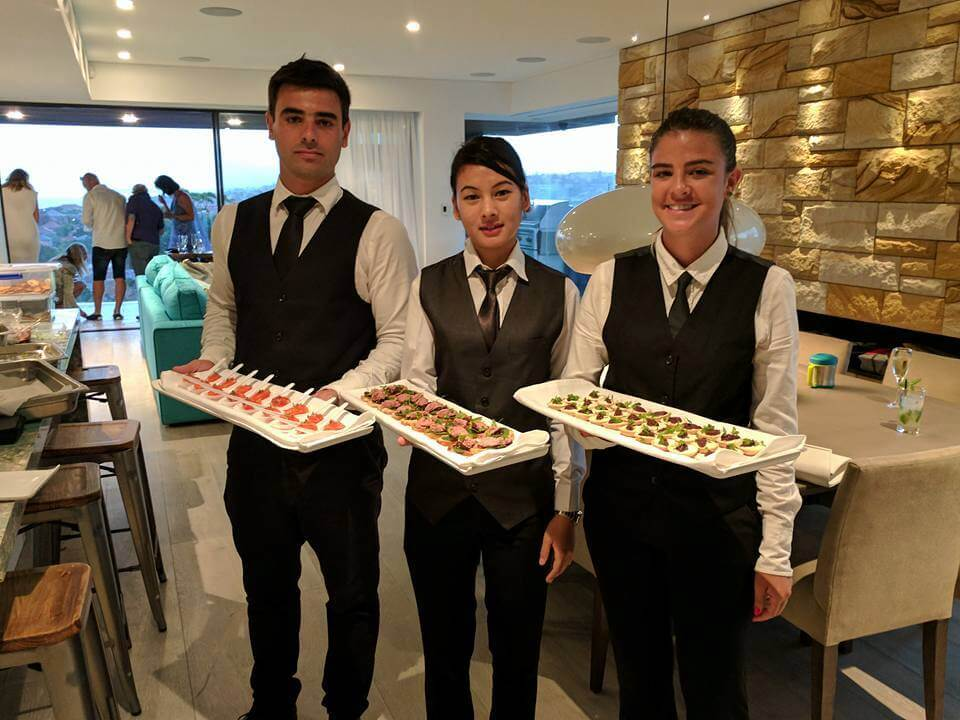waiters serving cocktail event party catering to our Sydney clients