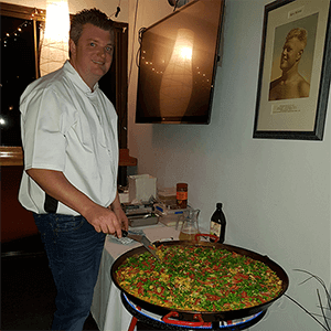 matt chef cooking paella for event party